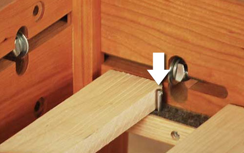 Bed slat behind pin