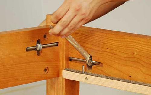 Tighten side rail bolts
